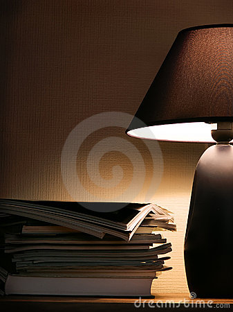Free Magazines Under Evening Lamp Light Royalty Free Stock Images - 608879