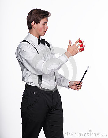 A magician holding  magic balls and wand