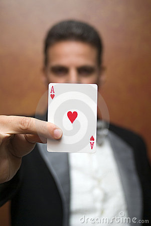 Magician performing with card