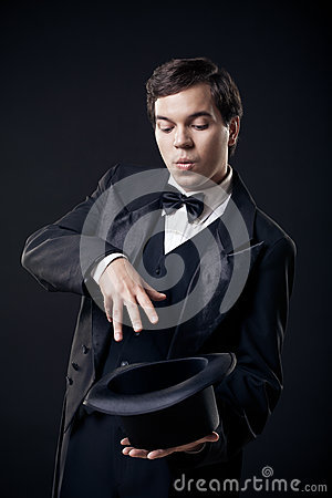 Magician showing tricks with top hat isolated
