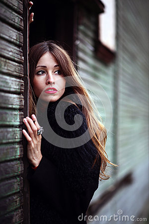 Magnificent charming gipsy close up portrait colorful dress and fur coat dressed outdoor