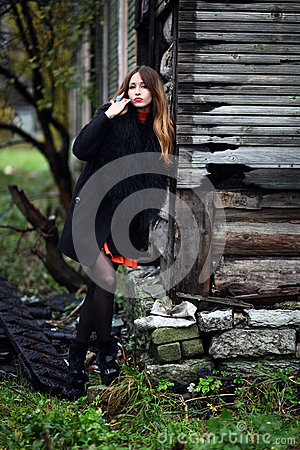 Magnificent charming gipsy colorful dress and fur coat dressed outdoor