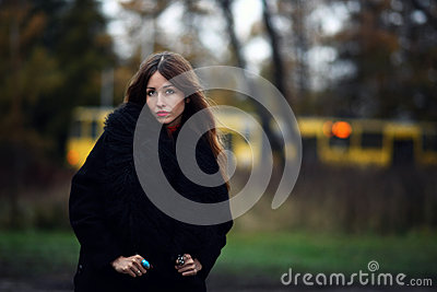 Magnificent charming gipsy woman staying in the forest outdoor