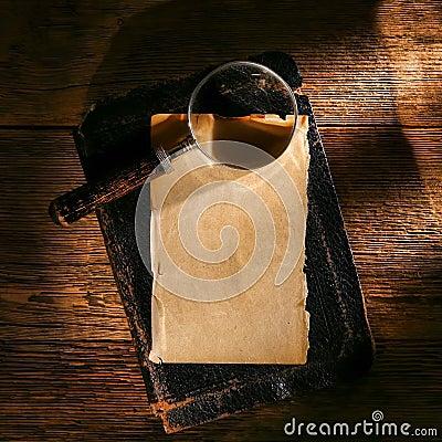 Magnifier on Antique Parchment paper Sheet on Book