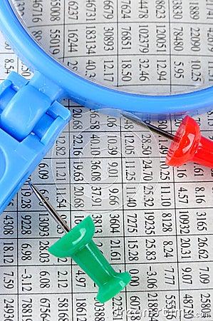 Magnifier, drawing pin and data sheet