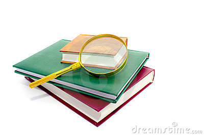 Magnifier lens and pile of books