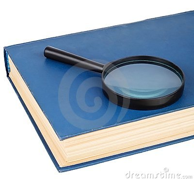 Magnifying glass on a blue book