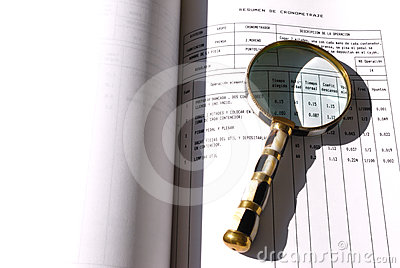 Magnifying glass on a document
