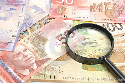 Magnifying glass on money background