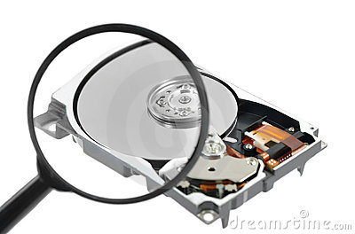 Magnifying glass over a computer harddrive