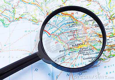 Magnifying glass over Napoli, Italy map