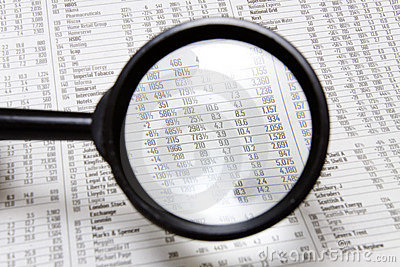 Magnifying glass and stocks