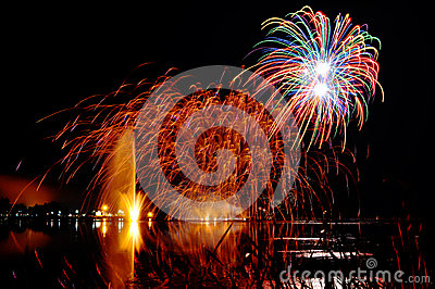 Magrnificient fireworks over a lake