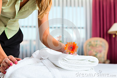 Maid doing room service in hotel