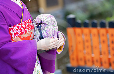 Maiko s hands with traditional bag
