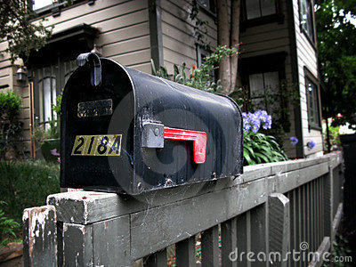 Mail box on a railing