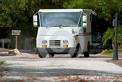 Mail delivery truck with mailboxes in background