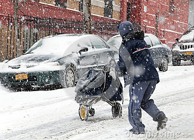 Mail man during snow storm in New York Editorial Photography