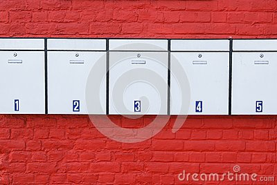 Mailboxes on red wall