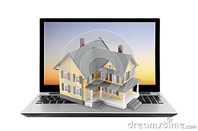 Maison jaune sur l ordinateur portable