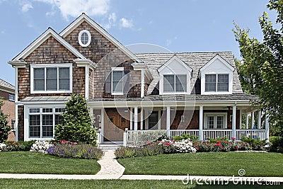 maison suburbaine avec le porche avant photos stock image 13458003. Black Bedroom Furniture Sets. Home Design Ideas
