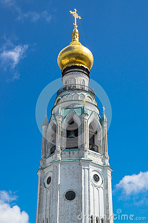 Majestic bell tower with golden dome shape