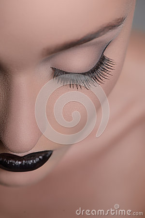 Make-up art. Close-up cropped image of women� face with closed