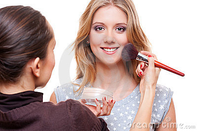 Make up artist doing make up