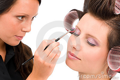 Make-up artist woman fashion model apply eyeshadow