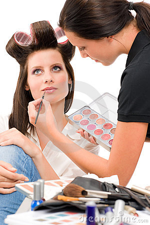 Make-up artist woman fashion model apply lipstick