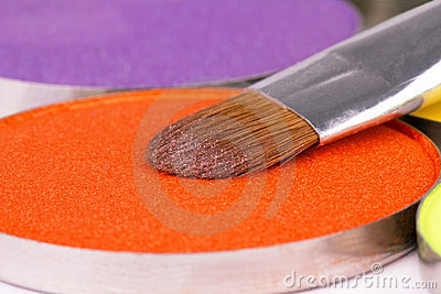 Make-up brush on orange eyeshadows round palette