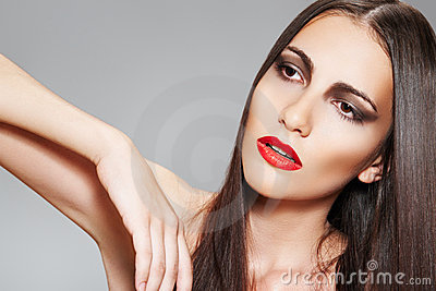 Make-up & cosmetics. Woman with healthy long hair