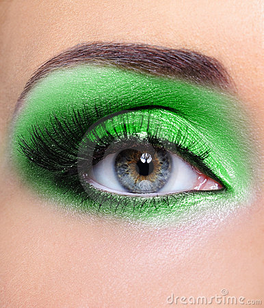 Make-up of woman eye with green eyeshadows