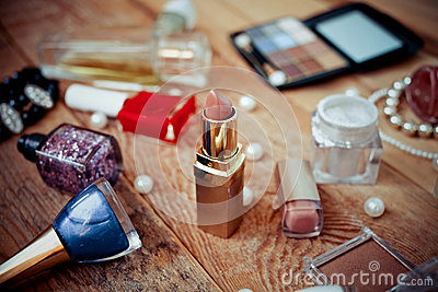Makeup accessories on wooden