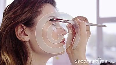 makeup artist applies eyes shadow stock video  video of