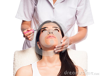 Makeup Artist Applying Mascara