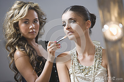 Makeup Artist Applying Foundation To Fashion Model