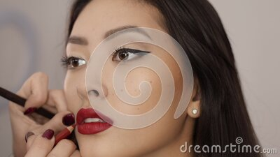 Makeup Artist Complete Make-up for Asian Woman stock video footage