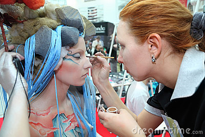 Makeup artist makes body art for model Editorial Photo