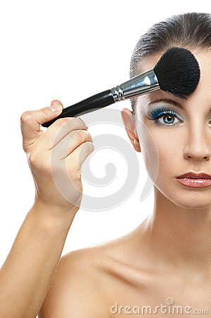 Makeup artist prepares forehead