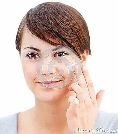 Makeup - Beautiful woman applying cream to face