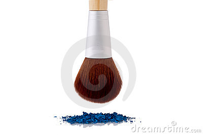 A makeup brush over blue makeup