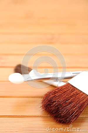 Makeup brushes on a wood