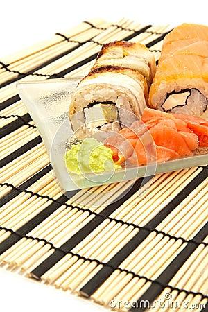 Maki sushi with wasabi on bamboo sushi mat
