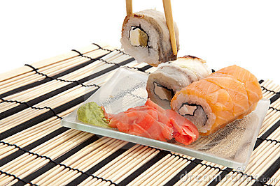 Maki sushi with wasabi on bamboo sushi mat