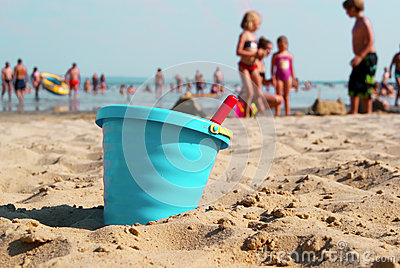Makig sandcastles on the beach. Editorial Stock Image