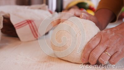 Making bread - woman hands kneading the dough stock video