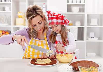 Making a cake - woman and little girl