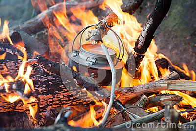 Making coffee on camp fire in the woods