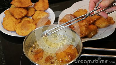 Making grandmother`s cakes a homemade sweet fried with honey